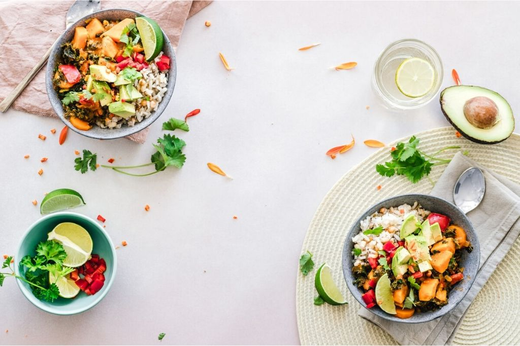 Salad bowls with fresh vegetables sitting on a table